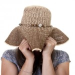 shy woman hides from relationship advice